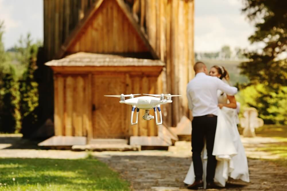 A DJI Phantom Drone Taking Photos at a wedding