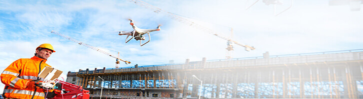 A man flying a drone for construcation needs